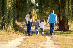 Big family walking in the park. stock image