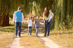 Big family walking in park. Rear view. Stock Photo