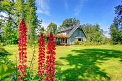 Big farmhouse with beautiful flowerbed Royalty Free Stock Photo
