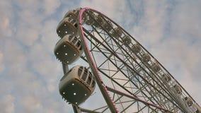 Big Farris wheel fragment. Big white Farris wheel with cloudy blue sky on background fragment Royalty Free Stock Photos