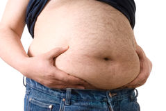 Big fat belly. Man holding his big fat belly isolated on white background Royalty Free Stock Images