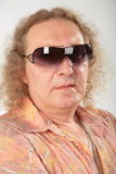 Big fat curly man in sunglasses Royalty Free Stock Photos