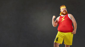 Big fat naked man in sports clothes royalty free stock photography
