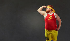 Big fat naked man in sports clothes stock photos