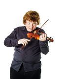 Big fat red-haired boy with small violin. Dmensions mismatch Stock Photography