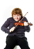 Big fat red-haired boy with small violin. Dmensions mismatch Royalty Free Stock Photography