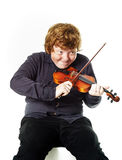 Big fat red-haired boy with small violin. Dmensions mismatch Stock Photo