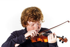 Big fat red-haired boy with small violin. Dmensions mismatch Stock Images