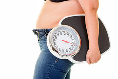 Big fat woman carrying large old bathroom scale Royalty Free Stock Photography