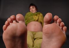 Big feet. Feet and fingers of pregnant woman Stock Photography