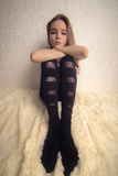 Big feet size. Sad pretty girl with big feet size Royalty Free Stock Photo
