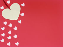 Big felt heart and small hearts on red  background Stock Photography