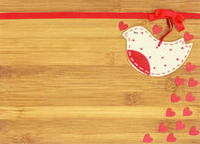 Big felt love bird and small hearts on wooden backgroundeart. Big felt heart white and red bird and small hearts on red background for valentines day, suitable Royalty Free Stock Photos