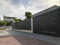 The big fence and private modern houses on the streets in Rishon LeZion, Israel. Close up shot Royalty Free Stock Photos