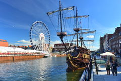 Big ferries wheel and a galeon replica in Gdansk Royalty Free Stock Photos