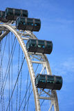 Big ferris wheel with cabins on blue sky, Singapore Flyer. View of Big ferris wheel with cabins on blue sky royalty free stock photo