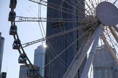 The big Ferris wheel in Central Hong Kong with commercial building behind Royalty Free Stock Photo