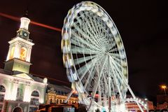 Evening view of the Andreevsky Descent. Big ferris wheel at Christmas market`s at the Kontraktova Square. Big ferris wheel at Christmas market`s at the royalty free stock images