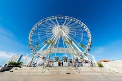 Big Ferris wheel. A big colourful ferris wheel against a deep blue sky Royalty Free Stock Photo