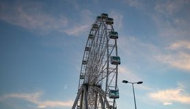 Big Ferris wheel in front of blue sky royalty free stock images
