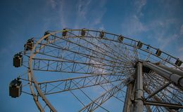 Big Ferris wheel in front of blue sky stock photos
