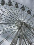 A big Ferris wheel in a grey sky. Ferris wheel cabins Royalty Free Stock Photography