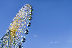 Big Ferris Wheel Over Blue Sky Stock Photo