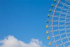 Big festival funfair ferris wheel against blue sky. Background Stock Image