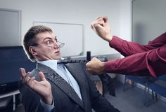 Big fight in office room. Aggressive office worker fighting with employee Royalty Free Stock Photos
