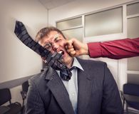 Big fight in office room. Office worker fighting with employee Royalty Free Stock Photography