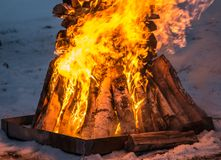 Big fire of birch trees at night. Outdoors stock photos