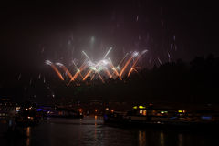 Big fireworks upon river with boats Royalty Free Stock Photo