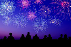 Big fireworks with silhouettes of people Stock Photos