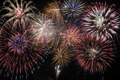 Big fireworks on sky. Large cascade fireworks at night as symbol for succes Royalty Free Stock Photo