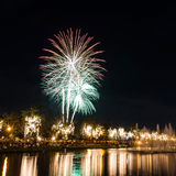Big fireworks in the sky over a parks Royalty Free Stock Photos