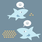 Big fish eat little fish. The concept of thinking big and thinking small Stock Photos