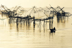 Big fishing net and the fisherman Royalty Free Stock Images