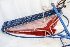 Big Fishing Rake. A blue and red fish rake on a fishing boat Royalty Free Stock Photo