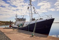Free Big Fishing Ship Anchored On The Dock On A Sunny Summer Day Stock Photos - 156893433