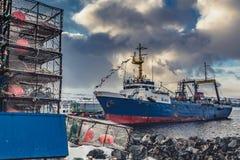 The big fishing ship at a pier stock photo