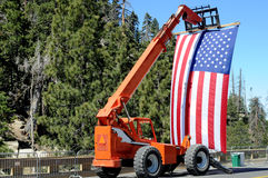 Big flag. Huge American flag displayed by crane with wheels stock photography