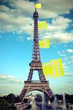 Big flag like a jackets symbol of Yellow vests movement on Eiffe. L Tower in Paris seen from the Trocadero and old toned effect royalty free stock photo