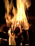 Big Flames on Stack of Logs Stock Photos
