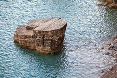 Big flat coastal stone on Adriatic Sea Stock Photo
