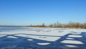 Flood field in winter, Lithuania. Big flood in winter field with small bushes stock photos