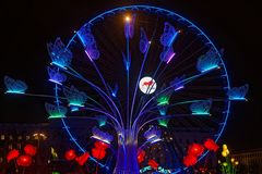 Big flower and big wheel on Place Bellecour Stock Image