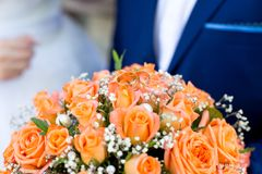Big flower bouquet. Big Bouquet and Two Wedding Rings. Goods for wedding. This photo is perfect for magazines, shops dealing with wedding dresses ceremonies Royalty Free Stock Images