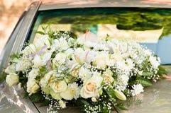Big flower bouquet on bonnet Stock Image