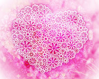 Big flower heart on pink. Big heart made of flowers on a textured pink background Royalty Free Stock Images