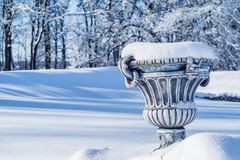 Big flower pot covered in fresh snow Royalty Free Stock Images